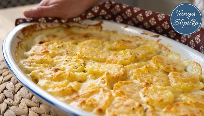 Запеченный картофель в сливках с чесноком под сырной корочкой - Видео-рецепт